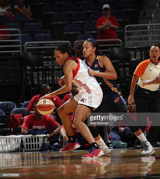 Monique Currie of the Washington Mystics handles the ball against Marissa Coleman#25 of the Indiana Fever in Game Two of the Eastern Conference...