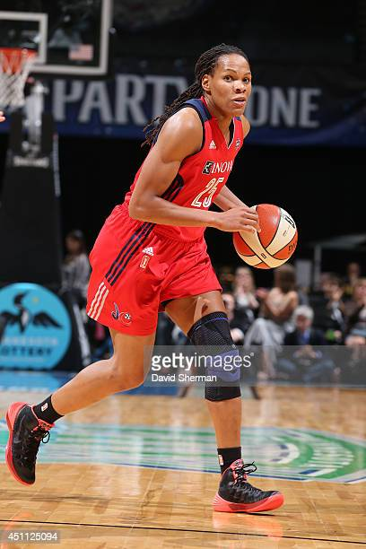 Monique Currie of the Washington Mystics handles the ball against the Minnesota Lynx on June 20 2014 at Target Center in Minneapolis Minnesota NOTE...