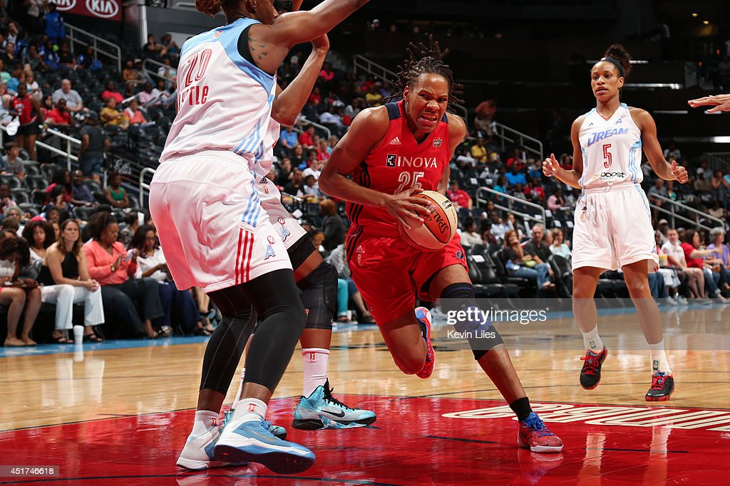 Monique Currie #25 of the Washington Mystics handles the ball against the Atlanta Dream at Philips Arena on July 5, 2014 in Atlanta, Georgia.