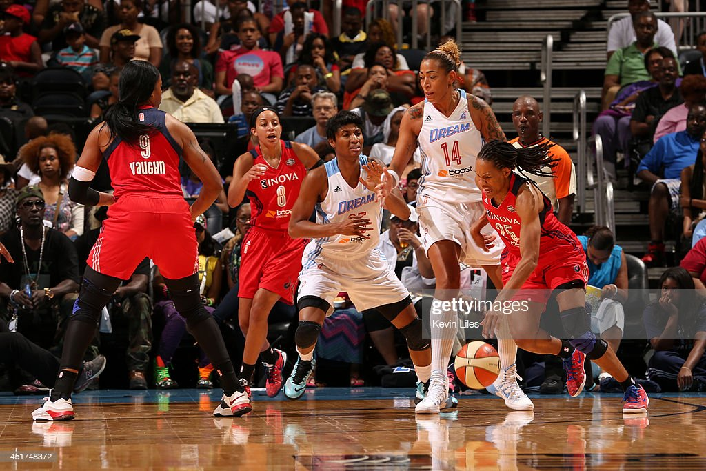 <a gi-track='captionPersonalityLinkClicked' href=/galleries/search?phrase=Monique+Currie&family=editorial&specificpeople=553598 ng-click='$event.stopPropagation()'>Monique Currie</a> #25 of the Washington Mystics handles the ball against the Atlanta Dream at Philips Arena on July 5, 2014 in Atlanta, Georgia.