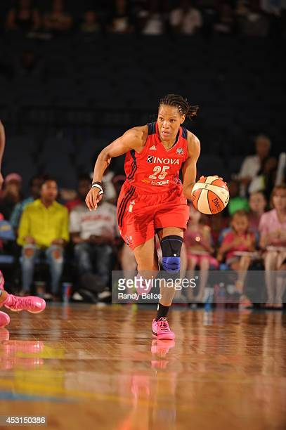 Monique Currie of the Washington Mystics handles the ball against the Chicago Sky during the game on August 03 2014 at the Allstate Arena in Rosemont...