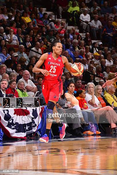 Monique Currie of the Washington Mystics handles the ball against the Connecticut Sun on August 15 2014 at the Mohegan Sun Arena in Uncasville...