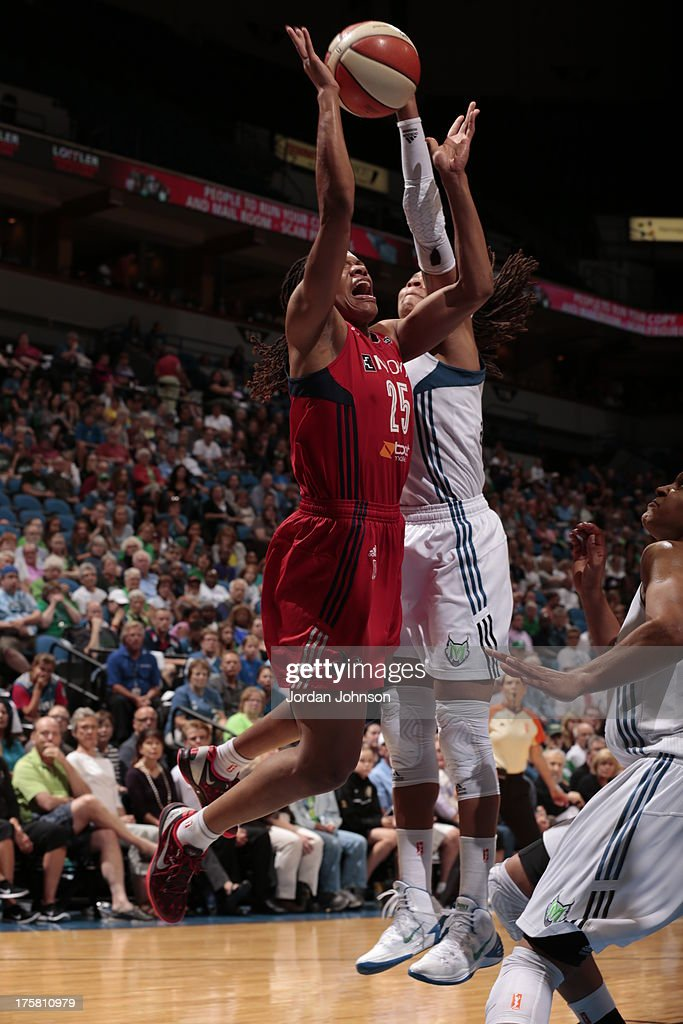 <a gi-track='captionPersonalityLinkClicked' href=/galleries/search?phrase=Monique+Currie&family=editorial&specificpeople=553598 ng-click='$event.stopPropagation()'>Monique Currie</a> #25 of the Washington Mystics is blocked by <a gi-track='captionPersonalityLinkClicked' href=/galleries/search?phrase=Seimone+Augustus&family=editorial&specificpeople=540457 ng-click='$event.stopPropagation()'>Seimone Augustus</a> #33 of the Minnesota Lynx during the WNBA game on August 8, 2013 at Target Center in Minneapolis, Minnesota.