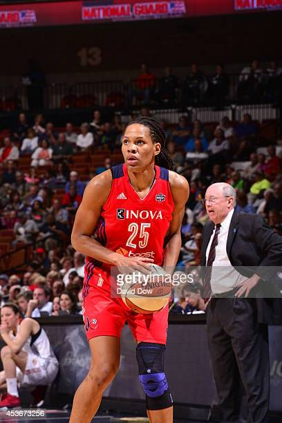 Monique Currie of the Washington Mystics looks to make a play with the ball against the Connecticut Sun on August 15 2014 at the Mohegan Sun Arena in...