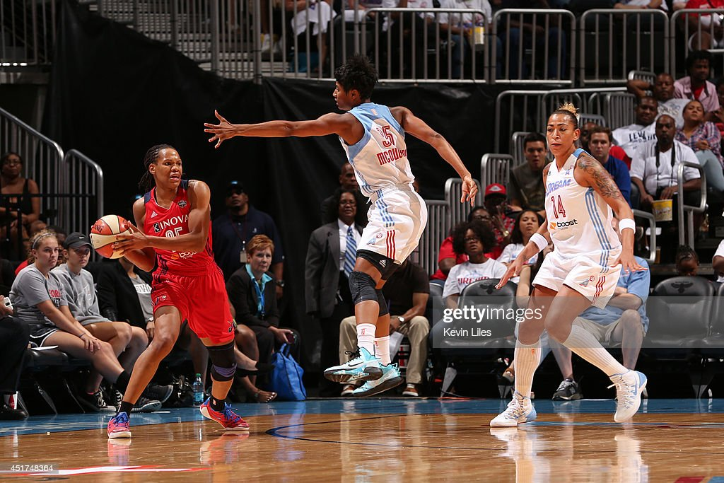 Monique Currie #25 of the Washington Mystics looks to pass against the Atlanta Dream at Philips Arena on July 5, 2014 in Atlanta, Georgia.