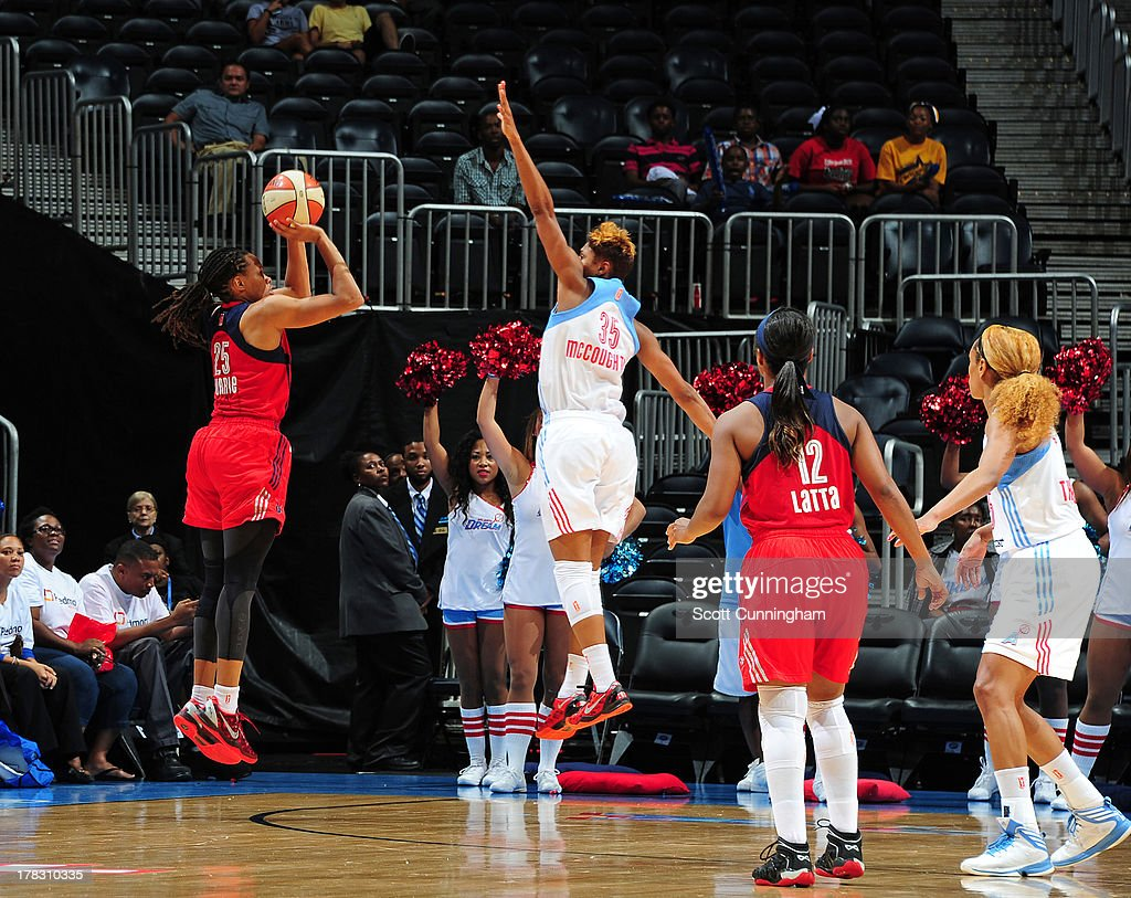 Monique Currie #25 of the Washington Mystics makes a three pointer to send the game to overtime against the Atlanta Dream at Philips Arena on August 28 2013 in Atlanta, Georgia.