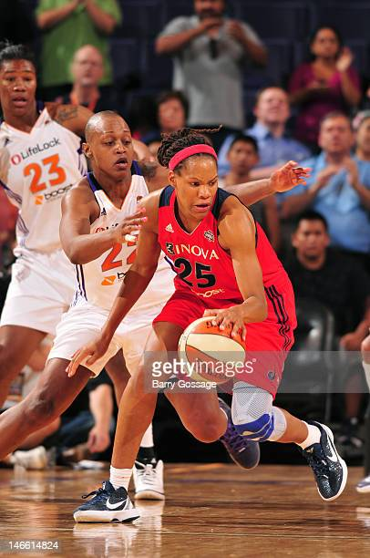 Monique Currie of the Washington Mystics moves the ball against Charde Houston of the Phoenix Mercury on June 20 2012 at US Airways Center in Phoenix...