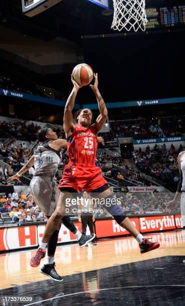 Monique Currie of the Washington Mystics shoots against Delisha MiltonJones of the San Antonio Silver Stars at the ATT Center on July 12 2013 in San...