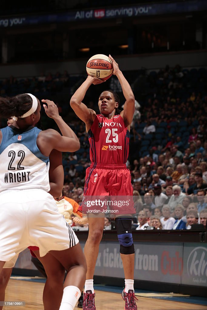 <a gi-track='captionPersonalityLinkClicked' href=/galleries/search?phrase=Monique+Currie&family=editorial&specificpeople=553598 ng-click='$event.stopPropagation()'>Monique Currie</a> #25 of the Washington Mystics shoots against Monica Wright #22 of the Minnesota Lynx during the WNBA game on August 8, 2013 at Target Center in Minneapolis, Minnesota.
