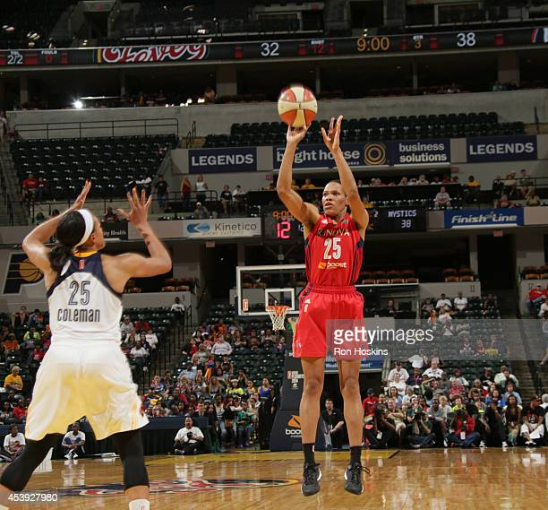 Monique Currie of the Washington Mystics shoots the ball against Marissa Coleman of the Indiana Fever in Game One of the Eastern Conference...