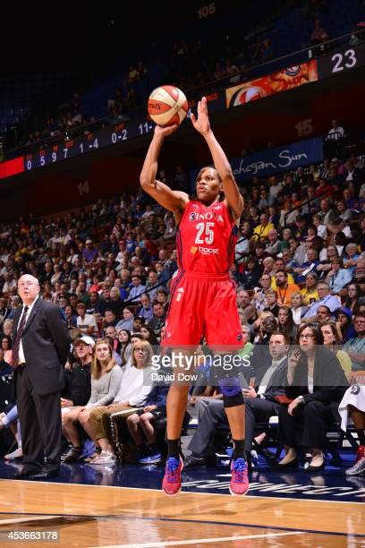 Monique Currie of the Washington Mystics shoots the basketball against the Connecticut Sun on August 15 2014 at the Mohegan Sun Arena in Uncasville...
