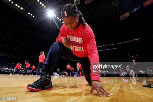 Monique Currie of the Washington Mystics stretches before a game against the San Antonio Stars at the Verizon Center on June 29 2014 in Washington DC...