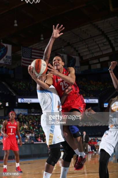 Monique Curry of the Washington Mystics goes to the basket past Sylvia Fowles of the Chicago Sky during the game on July 10 2013 at the Allstate...