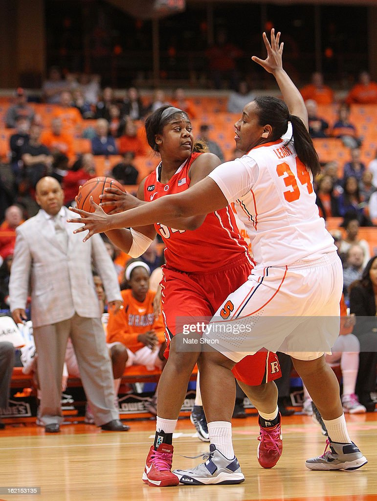 Monique Oliver #34 of the Rutgers Scarlet Knights attempts to pass the ball against Shakeya Leary #34 of the Syracuse Orange during the game at the Carrier Dome on February 19, 2013 in Syracuse, New York.