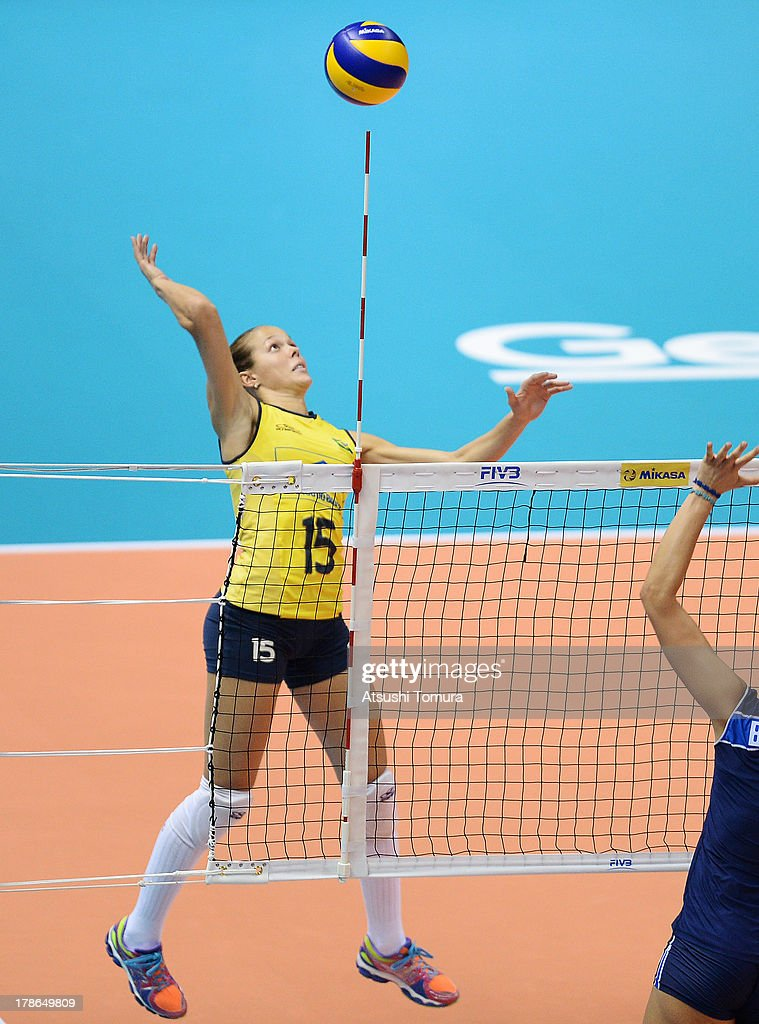 Monique Pavao of Brazil spikes the ball during day three of the FIVB World Grand Prix Sapporo 2013 match between Brazil and Italy at Hokkaido Prefectural Sports Center on August 30, 2013 in Sapporo, Hokkaido, Japan.