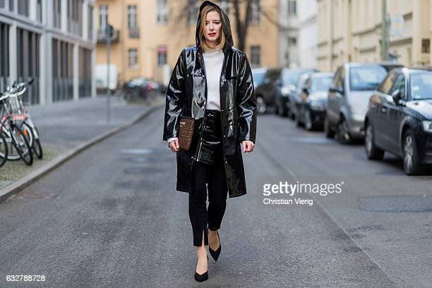 Monique Romanowski wearing wearing a white knit Macro Polo a black PVC jacket and sleather skirt Mango a Saint Laurent clutch and copped denim jeans...