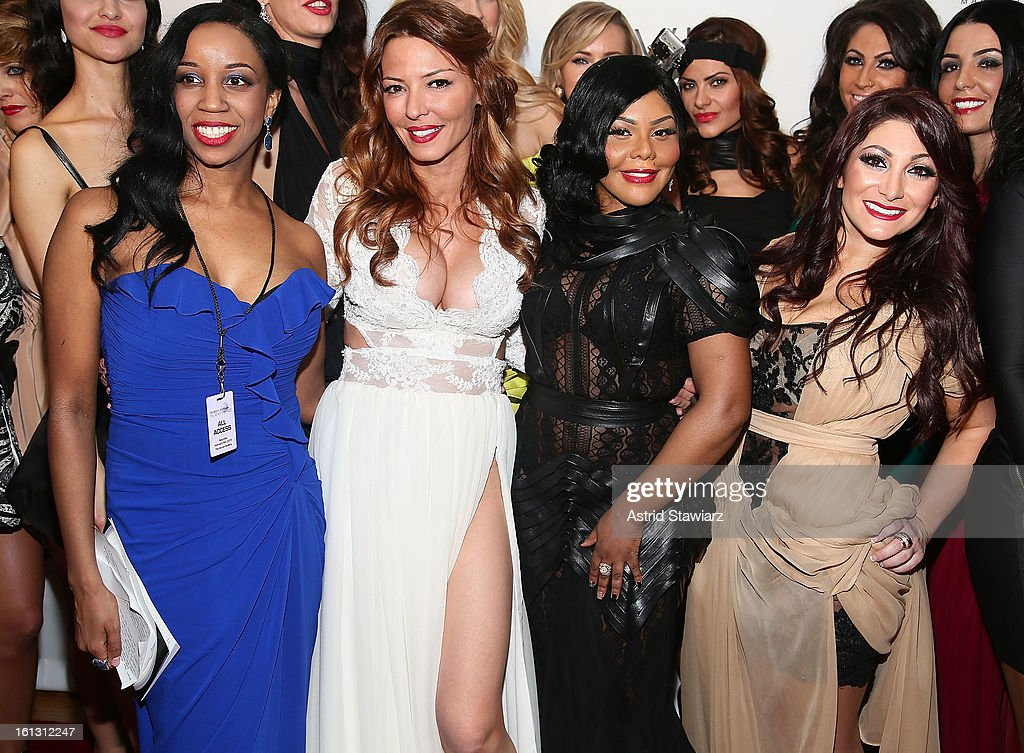 Monique Tatum, Drita D'Avanzo, Lil' Kim and Deena Cortese pose for photos backstage at the Reality of FASHION the Reality of AIDS fall 2013 fashion show during Mercedes-Benz Fashion Week at the Altman Building on February 9, 2013 in New York City.