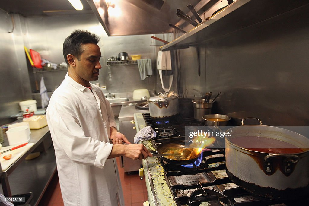 Monir Uddin, the head chef at Cafe Bangla curry house on Brick Lane, prepares a lamb curry on March 16, 2011 in London, England. From April 2011 the Government has ruled that only graduate-level workers will be allowed to migrate to the UK from outside the European Economic Area with the total number of skilled migrants capped at 21,700. Concerns have been raised on the effect of this legislation on curry restaurants as chefs will need a minimum of five years' experience, and must earn at least 28,260 GBP a year after accommodation and food.