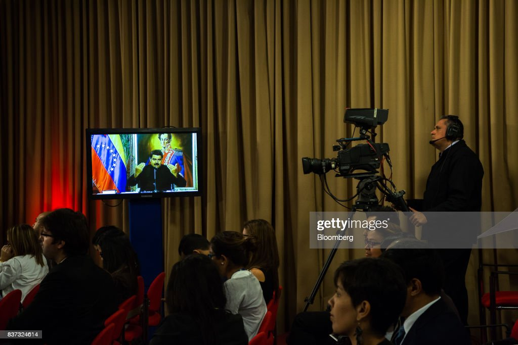 A monitor displays a live feed of Nicolas Maduro, Venezuela's president, while he speaks during a news conference in Caracas, Venezuela, on Tuesday, Aug. 22, 2017. Maduro said Venezuela's authoritarian regime is prepared for additional retaliation from the U.S., one of the crisis-torn nation's principal trade partners, including wide-reaching sanctions on its beleaguered economy and oil industry. Photographer: Wil Riera/Bloomberg via Getty Images