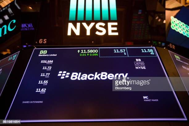 A monitor displays BlackBerry Ltd signage on the floor of the New York Stock Exchange after the company's listing migration to the NYSE in New York...