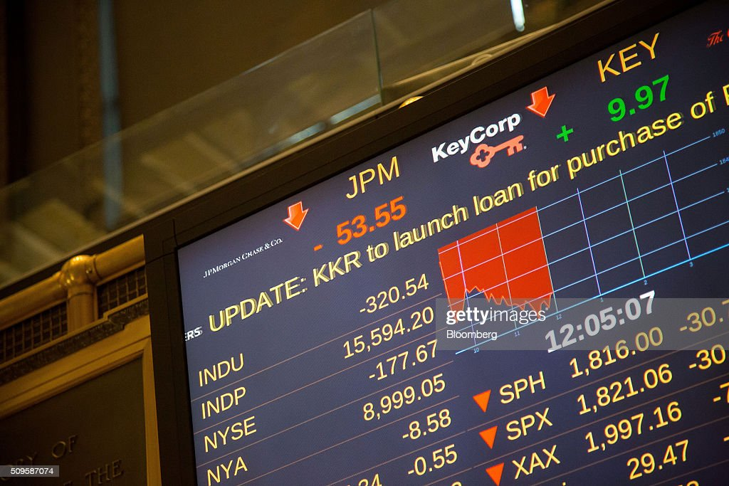A monitor displays financial news about JPMorgan Chase & Co. at the New York Stock Exchange (NYSE) in New York, U.S., on Thursday, Feb. 11, 2016. Global equities tumbled toward a bear market, with the Dow Jones Industrial Average plunging to 400 points, as financial markets signaled that investors have lost faith in central banks' ability to support the worldwide economy. Photographer: Michael Nagle/Bloomberg via Getty Images
