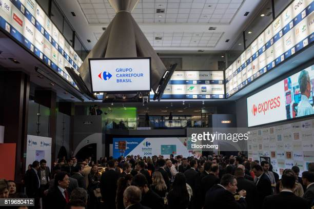 A monitor displays Grupo Carrefour Brasil signage during the initial public offering of Atacadao SA the Brazilian unit of French retailerCarrefour...