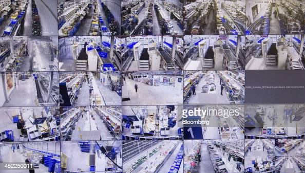 A monitor displays security footage from closed circuit television cameras at a Tesco Plc online distribution center in Erith UK on Wednesday Nov 27...