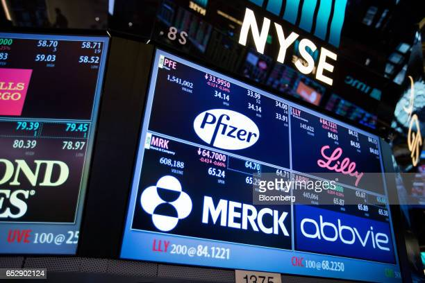 A monitor displays signage for Pfizer Inc Eli Lilly and Co AbbVie Inc and Merck Co Inc on the floor of the New York Stock Exchange in New York US on...
