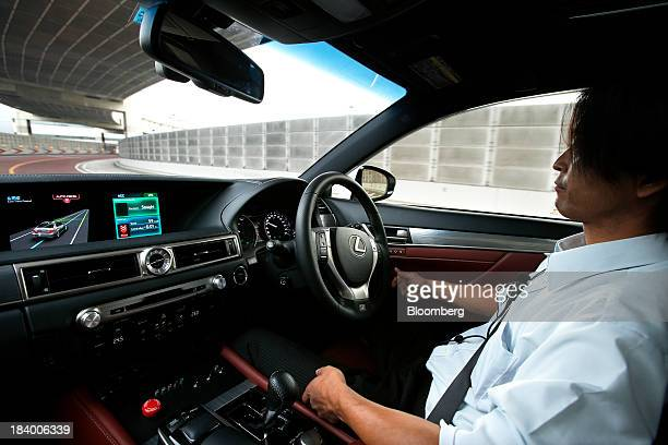 A monitor displays the status of the Lane Trace Control technology as an employee drives a Toyota Motor Corp Lexus vehicle equipped with the...