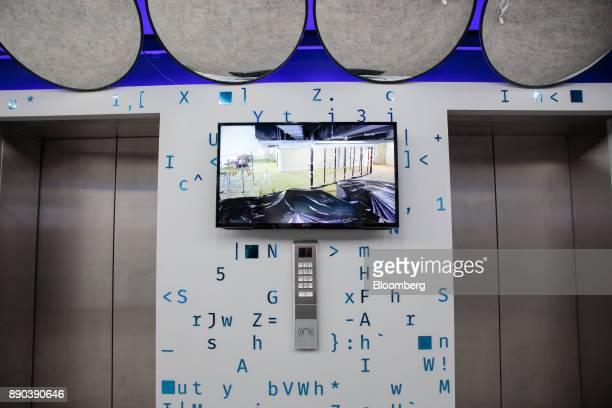 A monitor hangs on display near the elevators at the Facebook Inc Hack Station in Sao Paulo Brazil on Monday Dec 11 2017 The Facebook Hack Station is...