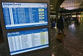 A monitor show Amtrak train departures and arrivals at Union Station on January 25 2016 in Washington DC The eastern United States emerged wearily...