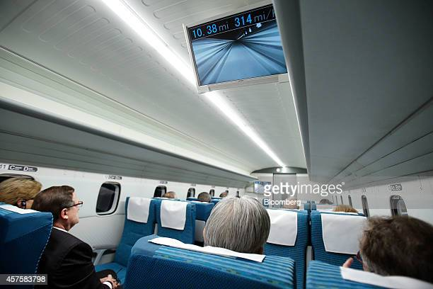 A monitor showing the speed and live view from the front of the train is seen inside the L0 series magnetic levitation train developed by Central...