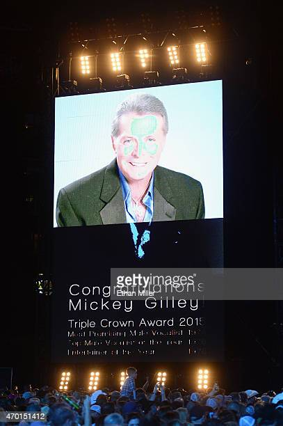 A monitor shows Triple Crown Award winner Mickey Gilley during ACM Presents Superstar Duets at Globe Life Park in Arlington on April 17 2015 in...