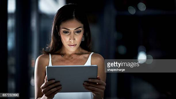 Monitoring work tasks on her tablet