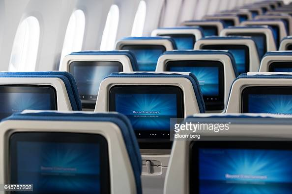 Monitors are seen inside the economy class cabin of a Boeing Co 7879 Dreamliner passenger aircraft operated by Korean Air Lines Co during a media...
