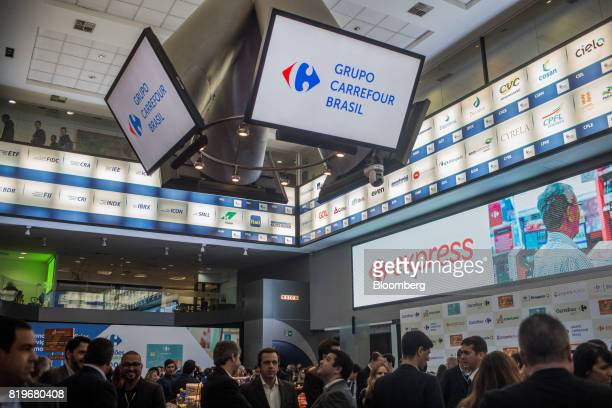 Monitors display Grupo Carrefour Brasil signage during the initial public offering of Atacadao SA the Brazilian unit of French retailer Carrefour SA...