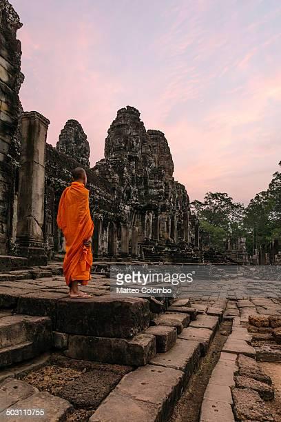 Monk at sunrise inside Angkor Wat temple, Cambodia