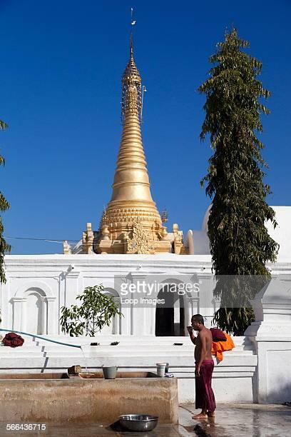 A monk brushing his teeth in Shwe Yaunghwe Kyaung Monastery near to Lake Inle in Myanmar