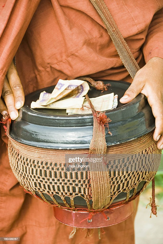 Monk holding his begging bowl (alms bowl), Myanmar : Stock Photo