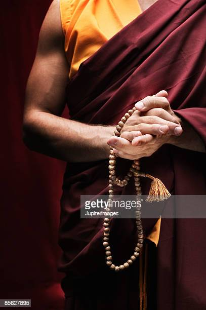 Monk holding prayer beads