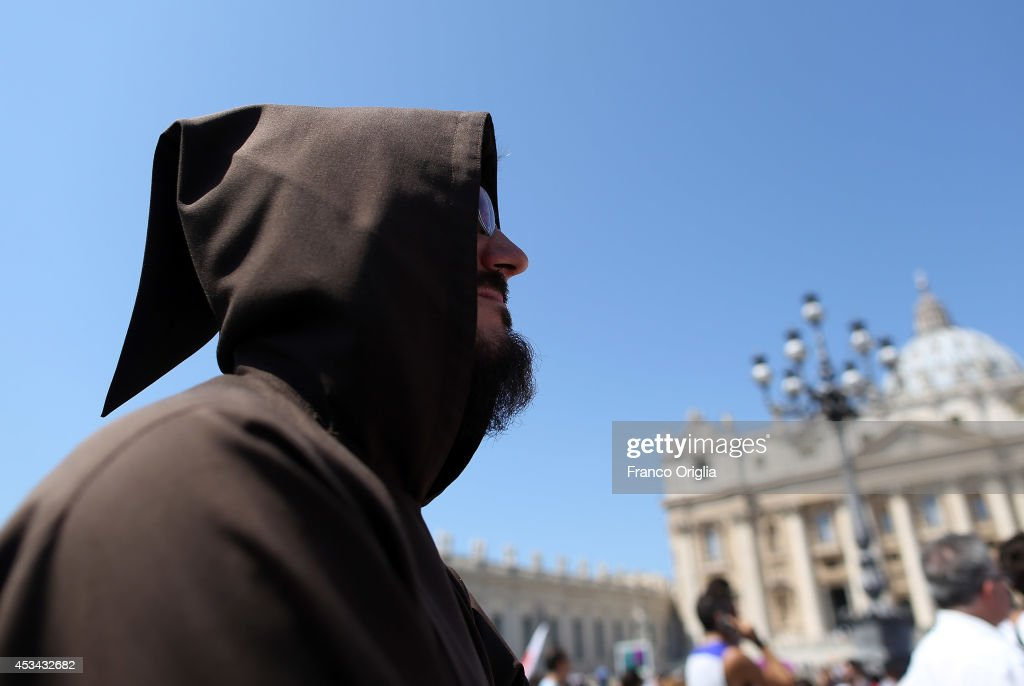 A monk in St Peter's Square waits for the traditional Angelus prayer of Pope Francis on August 10, 2014 in Vatican City, Vatican. Pope Francis renewed his call for prayer and assistance for those suffering in Iraq. He also prayed for an end to the fighting between Israeli forces and Hamas militants in Gaza, as well as for the victims of the Ebola virus. Pope Francis will visit South Korea from August 14 to August 18.