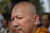 Monk is pictured with a religious tattoo on the top of his head inside the main temple of Wat Bang Phra in Nakhon Chai Si district Thailand about 50...