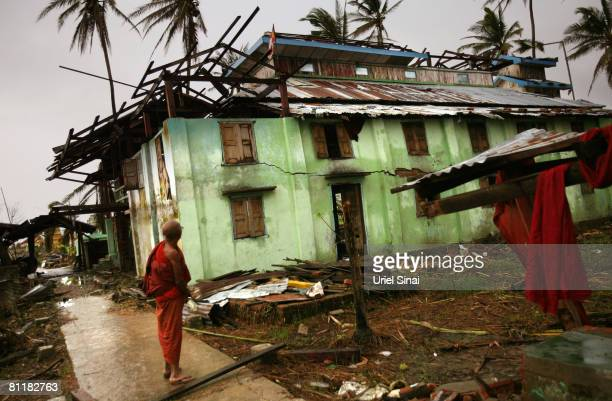 A monk looks at his a damaged monastery at the isolated village of Mingala Taungtan on May 20 2008 in the Ayeyarwaddy delta Myanmar It has been...
