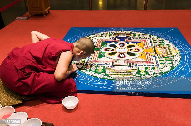Monk making sand mandala in new Buddha Tooth Relic Temple in Chinatown on 288 South Bridge Road.