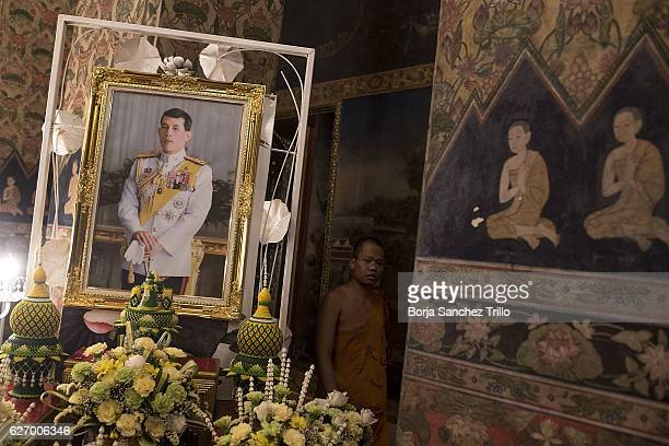 A monk pass next to the portrait of His Majesty King Maha Vajiralongkorn Bodindradebayavarangkun at Wat Pathum Wanaram after his proclamation as the...
