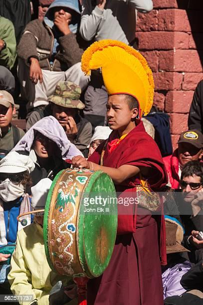 Monk playing drum