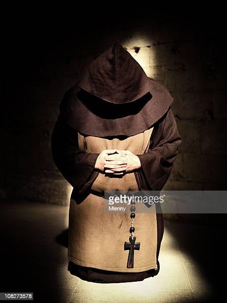 Monk Praying in the Shadows