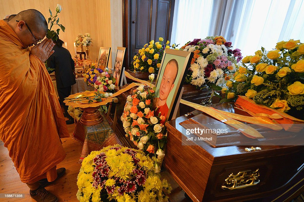 A monk prays at a service of remembrance for three thai Buddhist Monks who died in a car crash on Christmas Eve, at Oakvale Funeral Home on January 2, 2013 in Edinburgh, Scotland. Abbot Phramaha Pranom Thongphaiboon, 43, head of the Thai Buddhist community in Aberdeen, was killed in a car crash on Christmas Eve along with his colleagues Phramaha Kriangkrai Khamsamrong, 35, and Phramaha Chai Boonma, 36. The three men were travelling to the Dhammapadipa Temple in Edinburgh when they were involved in the head-on collision on the A68 near Pathhead, Midlothian.