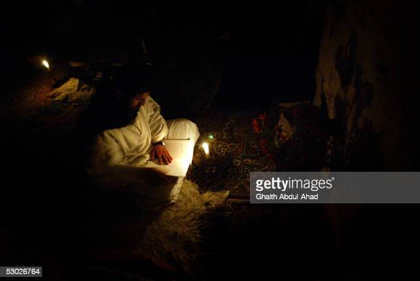 A monk reads the Bible during the evening prayers prays in the Monastery of St Moses the Abyssinian May 19 2005 east of Nebek Syria The 11th century...