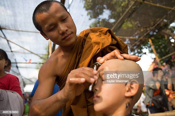 A monk shaves a Tai Yai boy's head during the Poy Sang Long Festival on April 1 2015 in Mae Hong Son Thailand Poy Sang Long is a Buddhist novice...